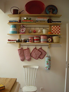 an aesthetically arrangement on kitchen shelf