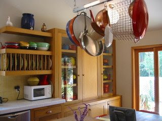 pots and pans hanging on the ceiling