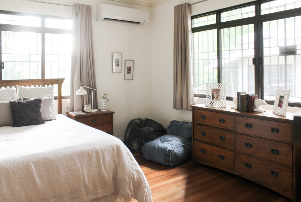 Home Tour with Kaho of Chuzai Living - the master bedroom filled with beanbag chair, desk chest, photo frames, lamps and books